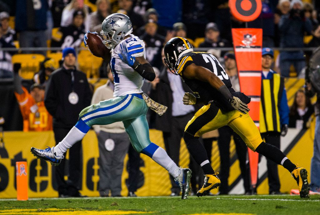 Dallas Cowboys running back Ezekiel Elliott (21) runs over the goal line for a touchdown ahead of Pittsburgh Steelers free safety Mike Mitchell (23) during the fourth quarter of their game on Sunday, November 13, 2016 at Heinz Field in Pittsburgh, Pennsylvania. The Cowboys won 35-30.  (Ashley Landis/The Dallas Morning News)