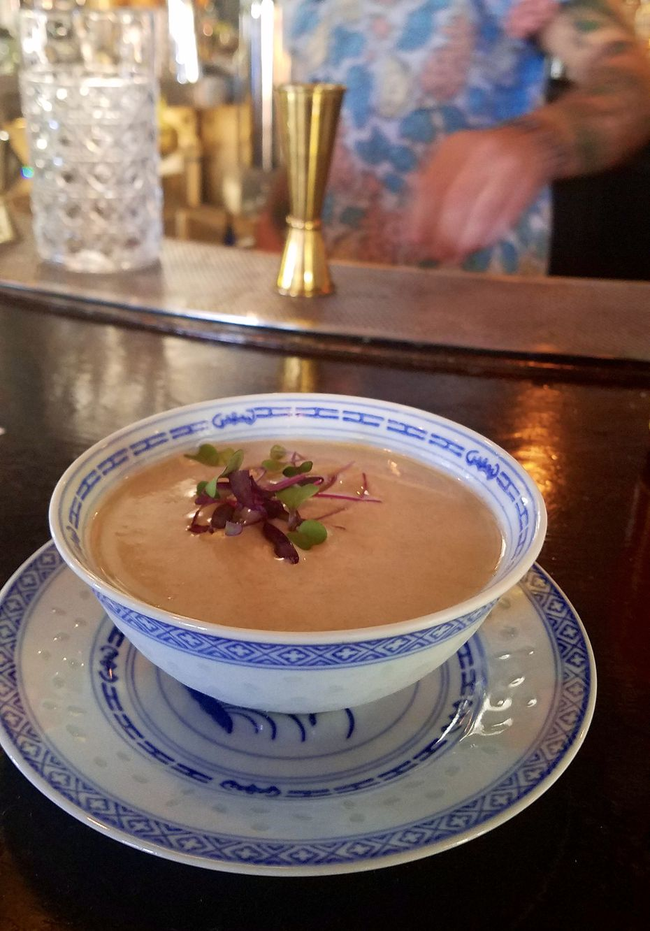 In Uptown, Bowen House's Do, Re, Miso cocktail, served in a small bowl, supplemented rice-based shochu with fennel flavor and white miso paste.