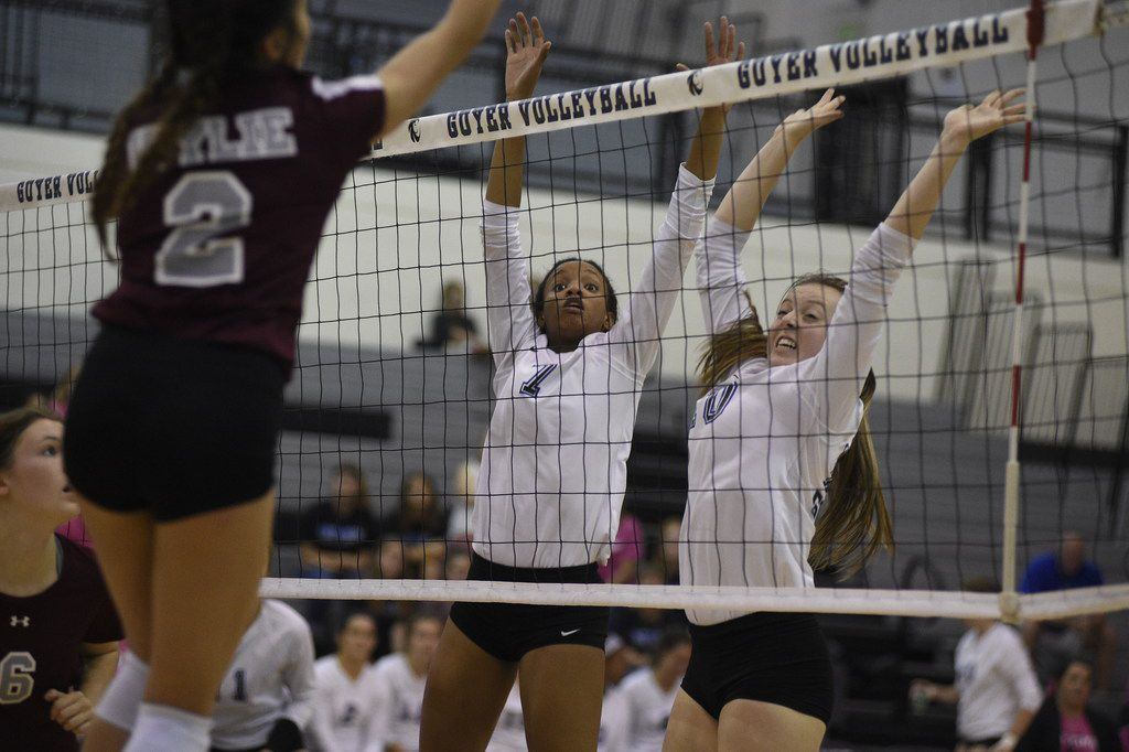 Guyer volleyball players Jordyn Williams (7) and Shea Slusser (10) attempt to defend aginst a spike. Wylie volleyball faced off against Guyer Tuesday night at Guyer High School. Tuesday, September 26, 2017, Guyer High School in Denton, Texas. Jake King/DRC