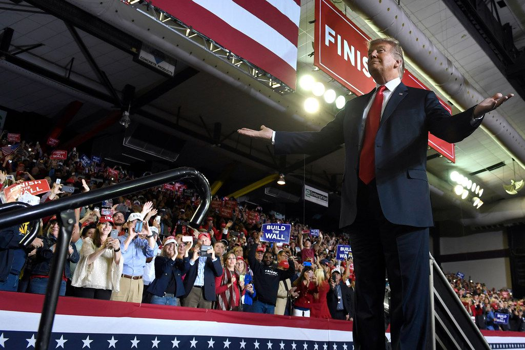 President Donald Trump gestures to the crowd as he speaks during a rally in El Paso on Feb. 11.