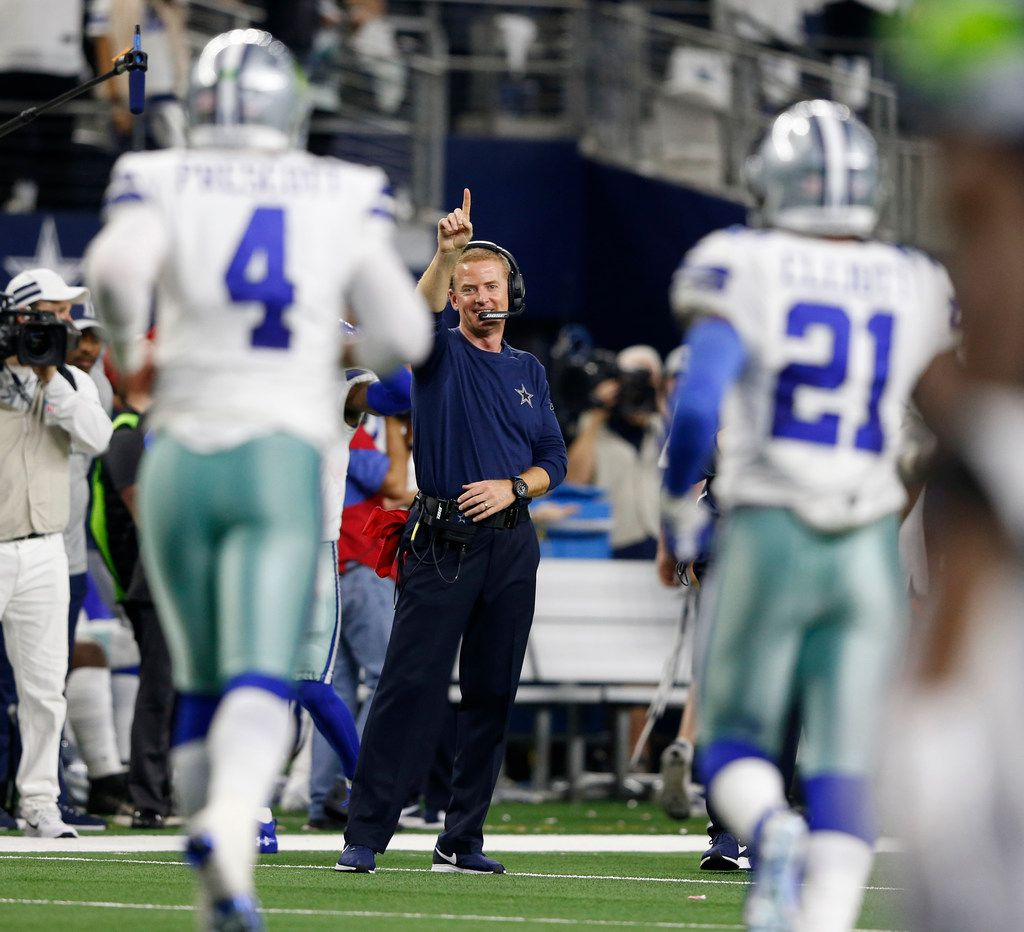 Dallas Cowboys head coach Jason Garrett signals for 1 after Dallas Cowboys quarterback Dak Prescott (4) scored a touchdown late in the fourth quarter of play at AT&T Stadium in Arlington, on Saturday, January 5, 2019. The Dallas Cowboys defeated the Seattle Seahawks 24-22 to advance to the next round. (Vernon Bryant/The Dallas Morning News)