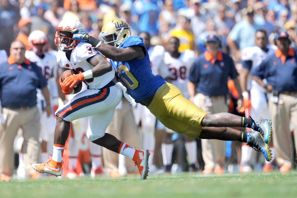 September 5, 2015; Pasadena, CA, USA; Virginia Cavaliers running back Olamide Zaccheaus (33) runs the ball against the defense of UCLA Bruins linebacker Myles Jack (30) during the first half at the Rose Bowl. Mandatory Credit: Gary A. Vasquez-USA TODAY Sports ORG XMIT: USATSI-226142