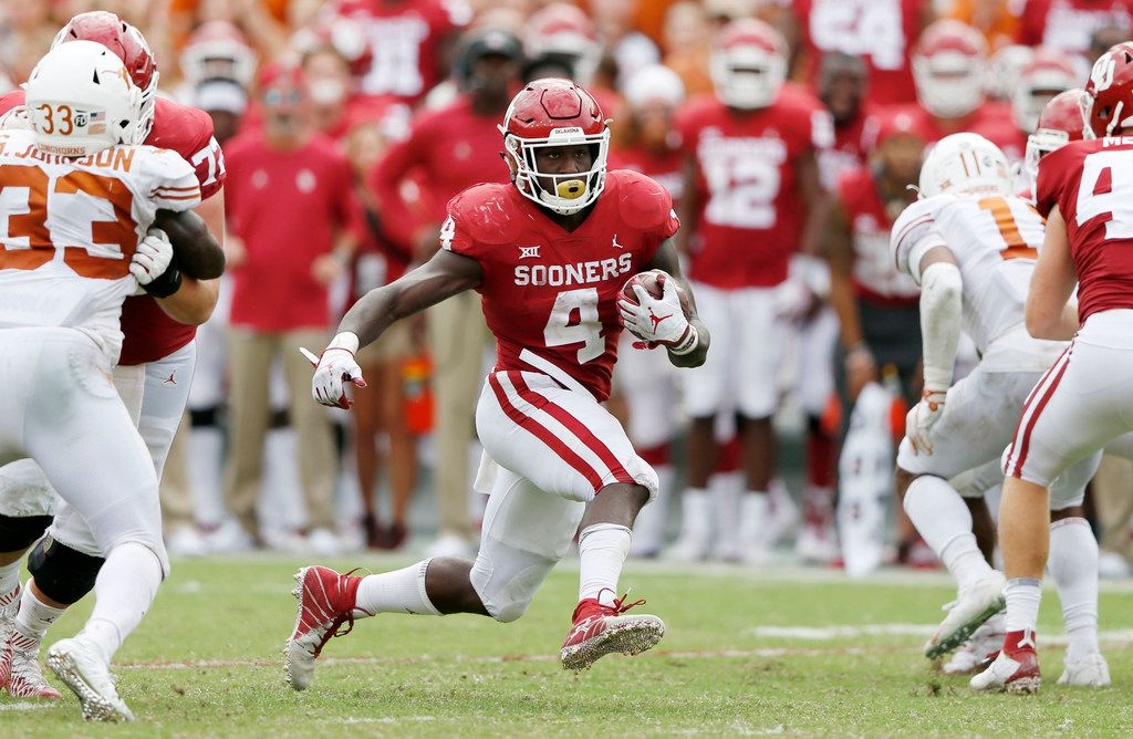 Oklahoma Sooners running back Trey Sermon (4) rushes up the field during the second half of play at the Cotton Bowl in Dallas on Saturday, October 6, 2018. Texas Longhorns defeated Oklahoma Sooners 48-45. (Vernon Bryant/The Dallas Morning News)