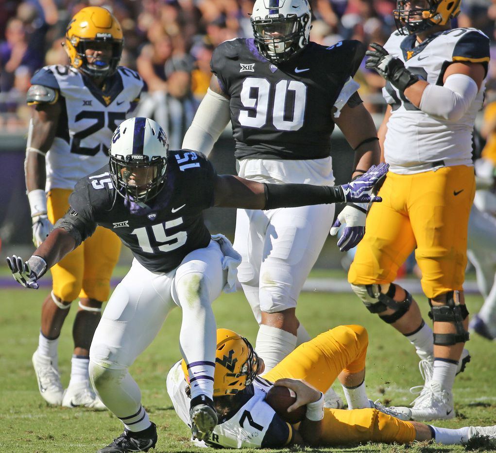 TCU defensive end Ben Banogu (15) celebrates sacking West Virginia quarterback Will Grier (7) in the first half during the West Virginia Mountaineers vs. the TCU Horned Frogs at Amon G. Carter Stadium in Fort Worth on Saturday, October 7, 2017. (Louis DeLuca/The Dallas Morning News)
