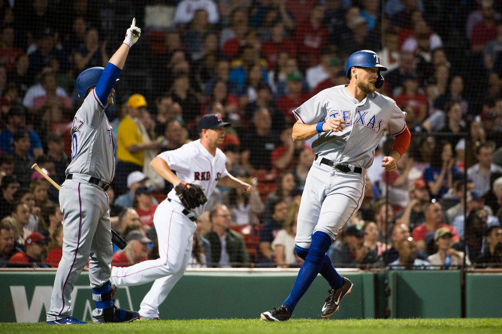 BOSTON, MA - JUNE 11: Tim Federowicz #50 celebrates as teammate Hunter Pence #24 of the Texas Rangers scores in the fifth inning against the Boston Red Sox at Fenway Park on June 11, 2019 in Boston, Massachusetts. (Photo by Kathryn Riley /Getty Images)