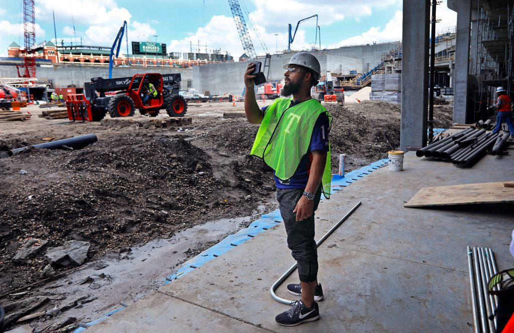 Texas Rangers second baseman Rougned Odorshortstop Elvis Andrus takes photos from the field level clubhouse at the new Globe Life Field under construction in Arlington, Texas, Tuesday, September 18, 2018. The Texas Rangers celebrated the One Million Man Hours by providing a barbecue lunch for it's nearly 900 workers. Rangers baseball players joined manager Jeff Banister in handing out construction helmet stickers marking the occasion. They also signed autographs and posed for photos.