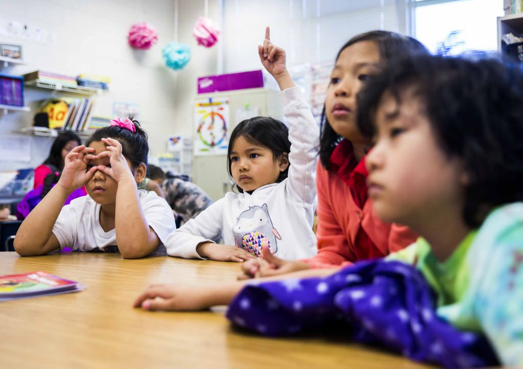 First graders (from left) Mu July Htoo, Mya Paw, Say Ku Paw and Soe Paw participated in an English as a Second Language class at Wallace Elementary in Dallas. The majority of the students in this class were Burmese refugees or came from refugee families.
