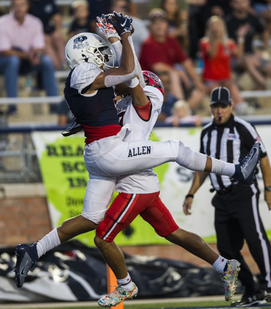 Cedar Hill cornerback Jalon Peoples (19) intercepts a pass intended for Allen wide receiver Blaine Green (8) in the end zone during the second quarter of a high school football game between Allen and Cedar Hill on Friday, August 30, 2019 at Eagle Stadium in Allen. (Ashley Landis/The Dallas Morning News)