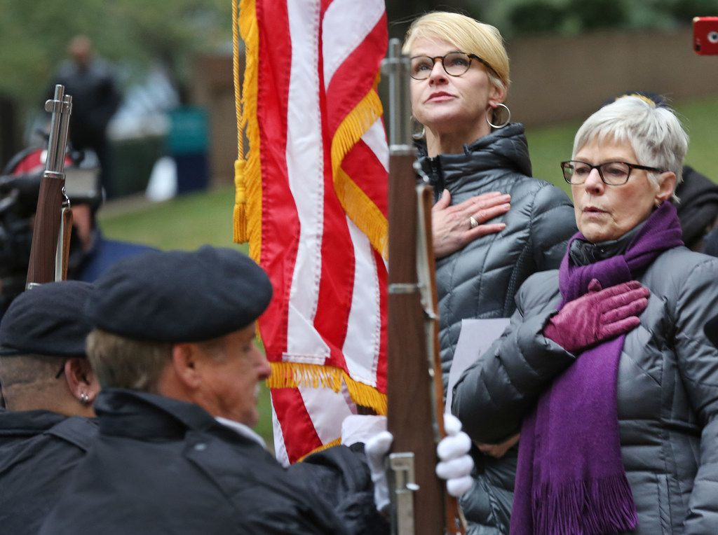 Regina Hunt, right, and Catherine Pryor Miller sing the national anthem during a Pearl Harbor remembrance held at Thanks-Giving Square in downtown Dallas, photographed on Thursday, December 7, 2017. (Louis DeLuca/The Dallas Morning News)