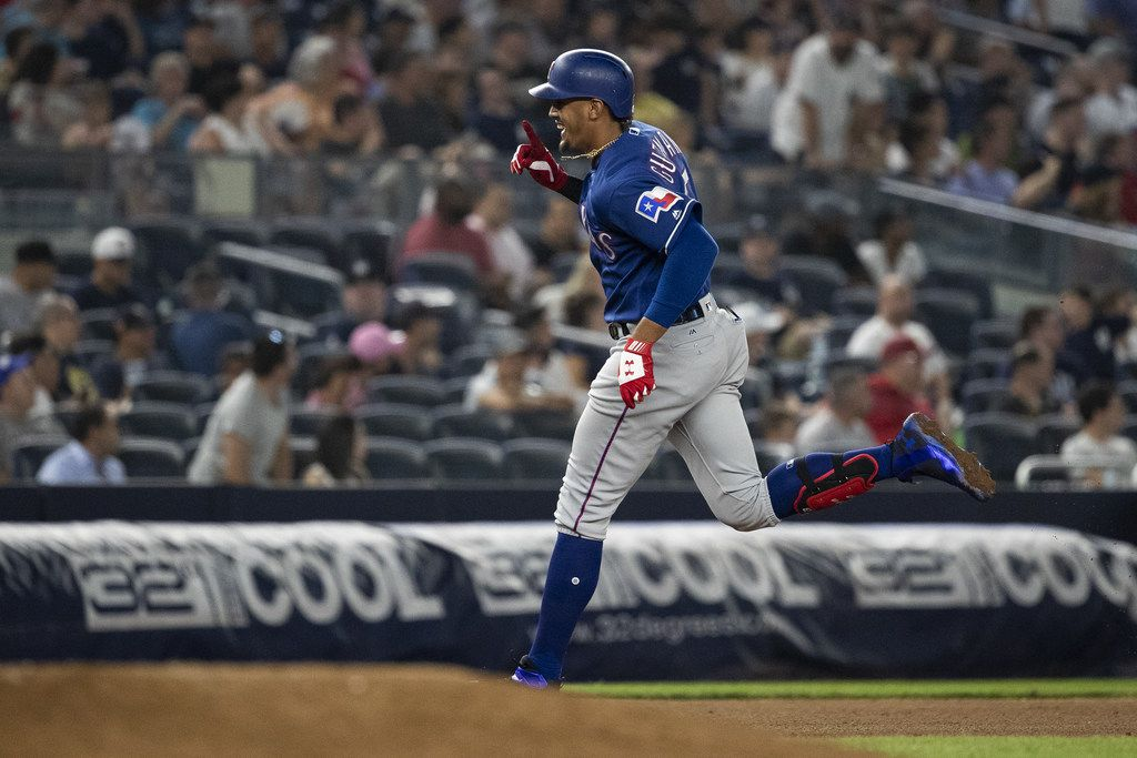 NEW YORK, NY - AUGUST 10: Ronald Guzman #67 of the Texas Rangers hits his third homerun of the night at the top of the seventh inning against the New York Yankees during their game at Yankee Stadium on August 10, 2018 in New York City. (Photo by Michael Owens/Getty Images)