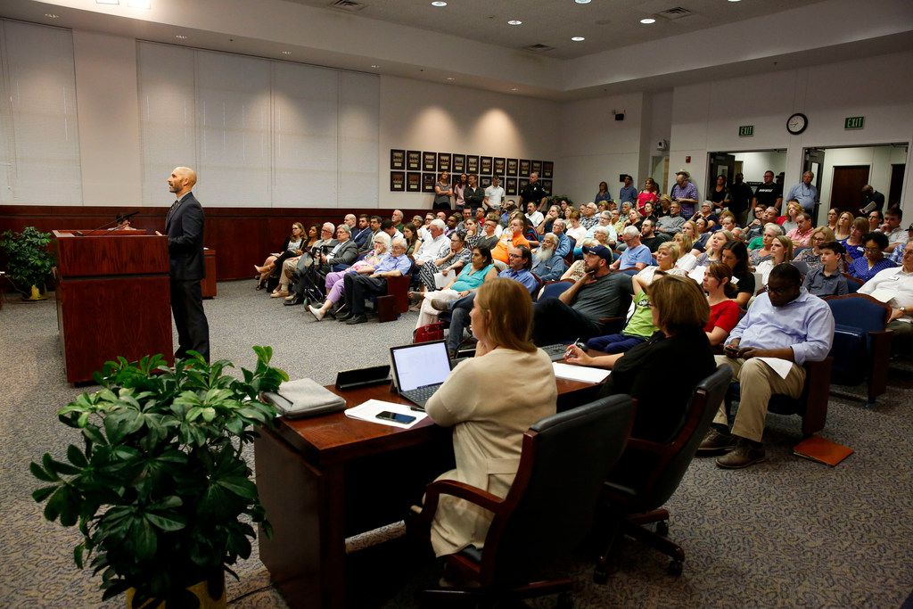 A large crowd of residents listen as the Allen City Council conduct a public hearing to adopt an ordinance to establish a planned development including businesses, apartments on Tuesday, August 13, 2019. (Brian Elledge/The Dallas Morning News)
