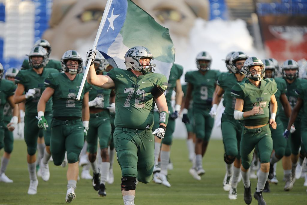 Reedy High School offensive lineman Ethan Baker (72) carries a flag onto the field before kick off as Reedy High School hosted Plano West High School in a non-district football game at Toyota Stadium in Frisco on Thursday, August 28, 2019. (Stewart F. House/Special Contributor)