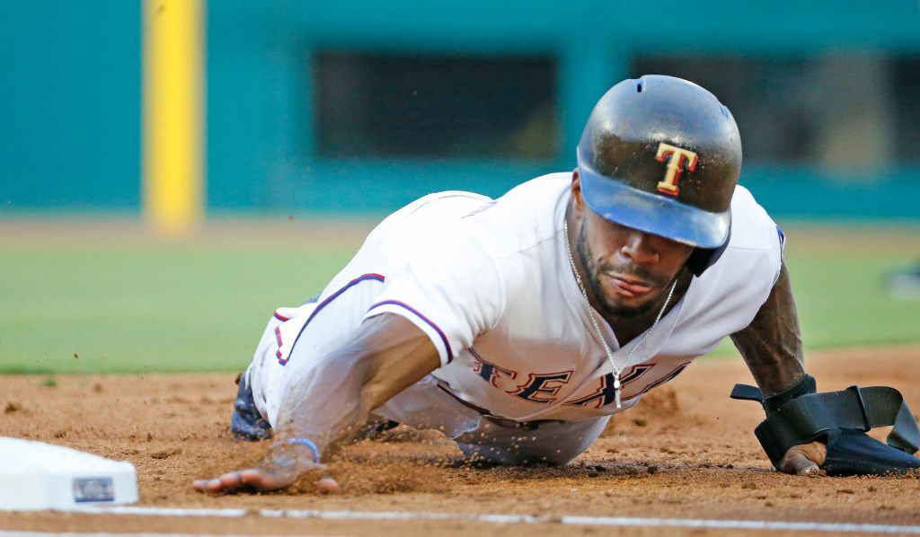 Texas Rangers left fielder Delino DeShields (3) dives back to first on a pickoff attempt in the first inning during the Detroit Tigers vs. the Texas Rangers major league baseball game at Globe Life Park in Arlington on Tuesday, August 15, 2017. (Louis DeLuca/The Dallas Morning News)