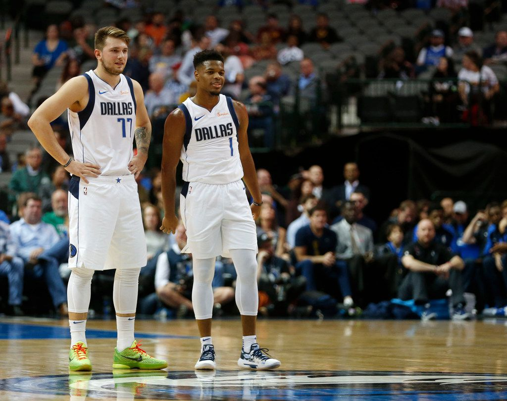 Dallas Mavericks guard Luka Doncic (77) and Dallas Mavericks guard Dennis Smith Jr. (1) during the first of two free throws are attempted in a game against the Charlotte Hornets in the first half of a preseason game at American Airlines Center in Dallas on Friday, October 12, 2018. (Vernon Bryant/The Dallas Morning News)