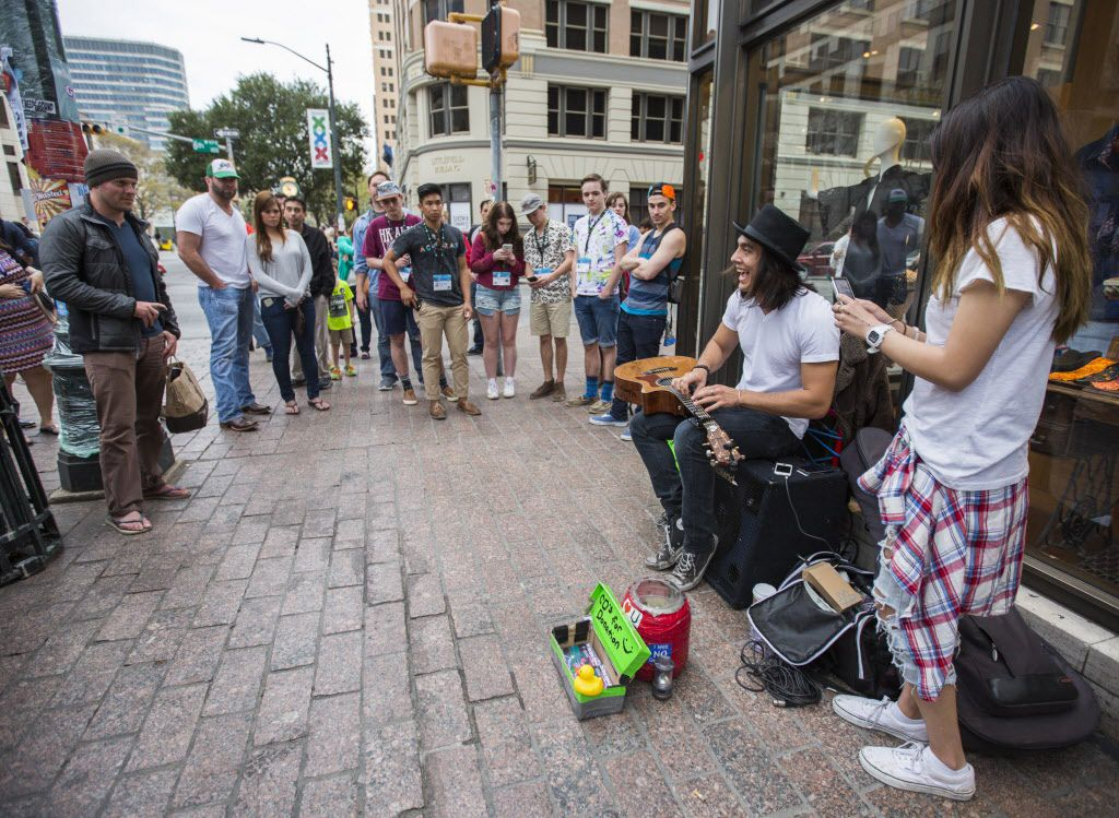 Street musician Charles Rangel of Los Angeles plays guitar on Congress Avenue during the 2015 SXSW interactive and film festival on Sunday, March 15 in downtown Austin.
