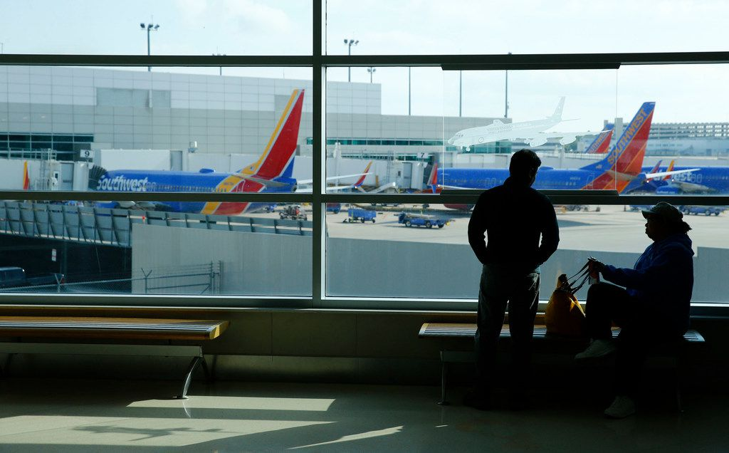 Lorenza Bowen (left) and Uyvonnie Ford wait for their flight at Dallas Love Field Airport on April 23, 2018. Behind them are Southwest Airlines planes at the gates. (Nathan Hunsinger/The Dallas Morning News)