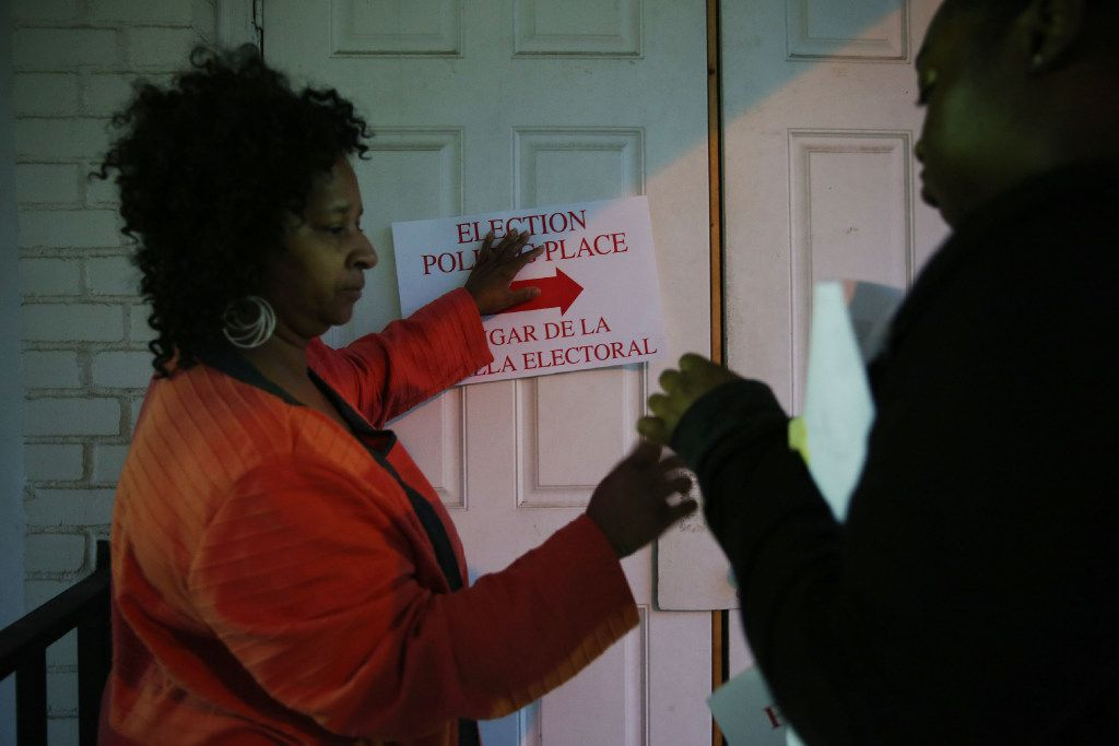 Democratic judge trainer Claudia Fowler (left) helps to setup voting precinct 3045 with student volunteer Kimberlyn Coleman (right) at Gethsemane Missionary Baptist Church on Solar Lane in the Joppa neighborhood of Dallas before polls open on Election Day Tuesday November 8, 2016. Fowler was a precinct judge at this location for over 20 years. (Andy Jacobsohn/The Dallas Morning News)
