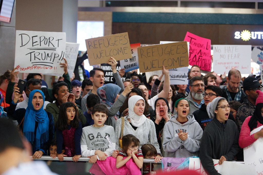 Protesters gathered at DFW International Airport to denounce President Donald Trump's executive order shortly after it was issued in January. (G. Morty Ortega/Getty Images)