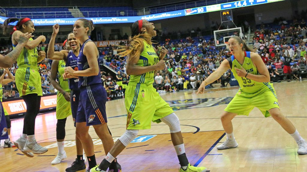 Dallas Wings forward Glory Johnson (25) and forward Theresa Plaisance (55)celebrate a fourth quarter score for the Wings in Phoenix's 101-100 overtime win during the Dallas Wings vs. Phoenix Mercury WNBA basketball game at the UTA College Park Center in Arlington, Texas on Thursday, August 10, 2017. (Louis DeLuca/The Dallas Morning News)