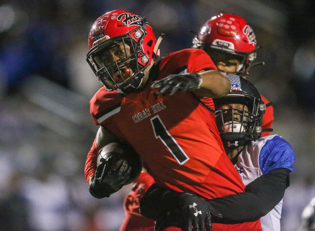 Cedar Hill wide receiver Quin Bright (1) carries the ball as he is defended by Mansfield Summit outside linebacker Xavier Toliver (13)  during the first half of a high school football game between Cedar HIll and Mansfield Summit on Friday, October 11, 2019 at Longhorn Stadium in Cedar Hill, Texas. (Shaban Athuman/Staff Photographer)