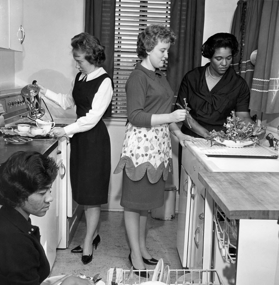 In March 1963, students participate in a home economics class at West Virginia State College at Institute, W.Va.