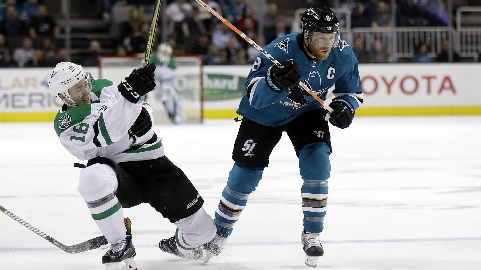 Dallas Stars' Tyler Pitlick, left, defends against San Jose Sharks' Joe Pavelski during the first period of an NHL hockey game Tuesday, April 3, 2018, in San Jose, Calif. (AP Photo/Marcio Jose Sanchez)