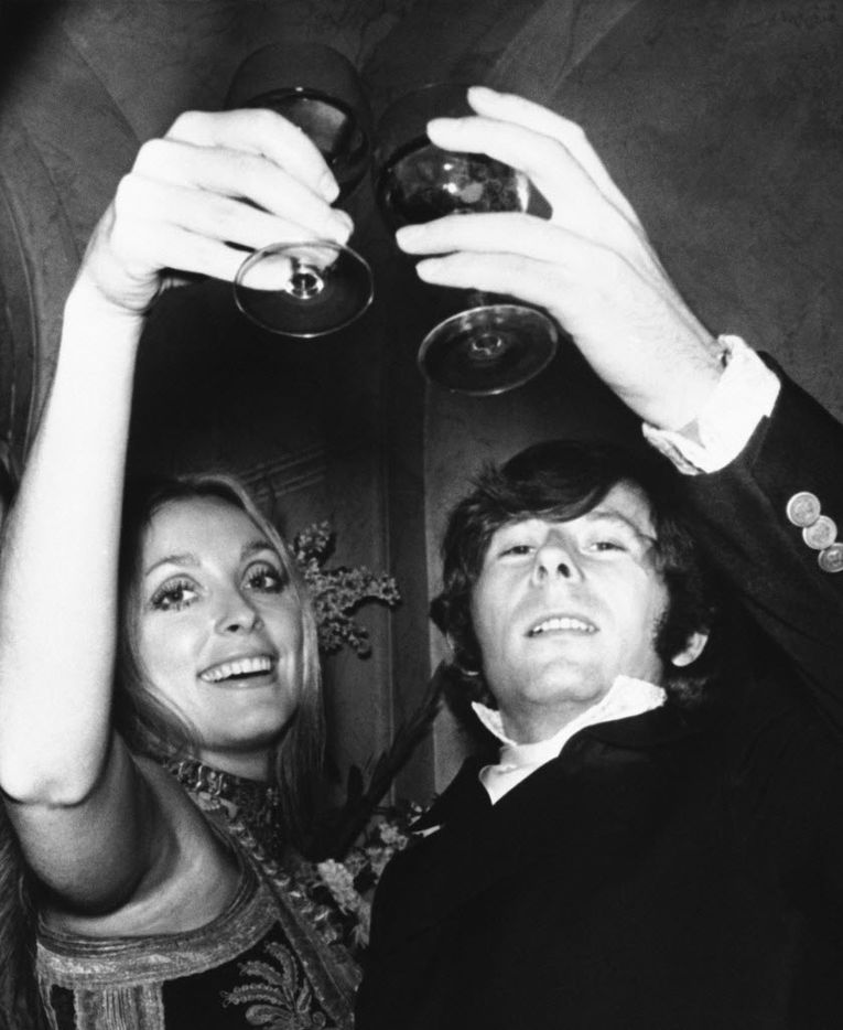 In this Feb. 18, 1969 file photo, Roman Polanski is shown with his wife, the actress Sharon Tate, toasting the opening of Rosemary's Baby in London. (AP Photo)