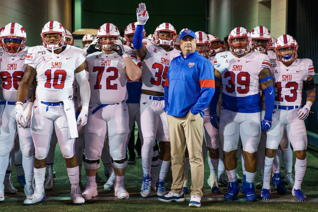 SMU head coach Sonny Dykes stands with his team before Mustangs take the field for an NCAA football game against Memphis at Liberty Bowl Memorial Stadium on Saturday, Nov. 2, 2019, in Memphis, Tenn. (Smiley N. Pool/The Dallas Morning News)