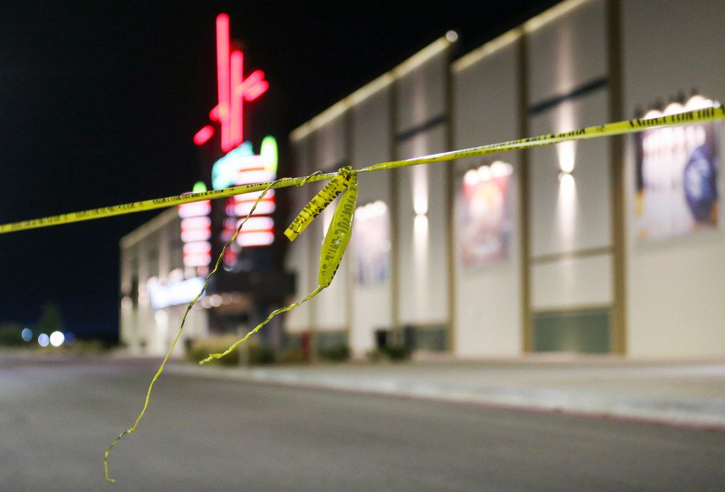 Police tape hangs at a Cinergy movie theater in Odessa. Seven people have died after more than 20 people were shot Saturday when a gunman hijacked a postal truck and began shooting randomly, authorities say.
