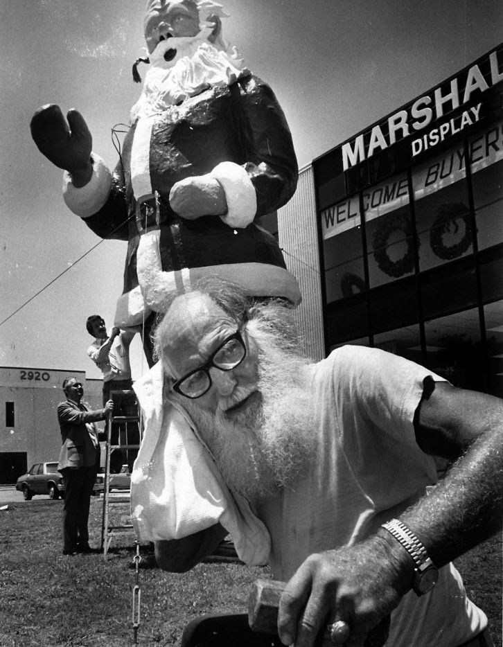 Santa Claus definitely was out of place on June 26, 1980, the hottest day ever in Dallas.  While his creator, Jack Bridges, struggled with the 113-degree heat, the giant Santa seemed impervious to the weather.  The figure was on display at Stemmons and Inwood for the Christmas in July Gift Show.