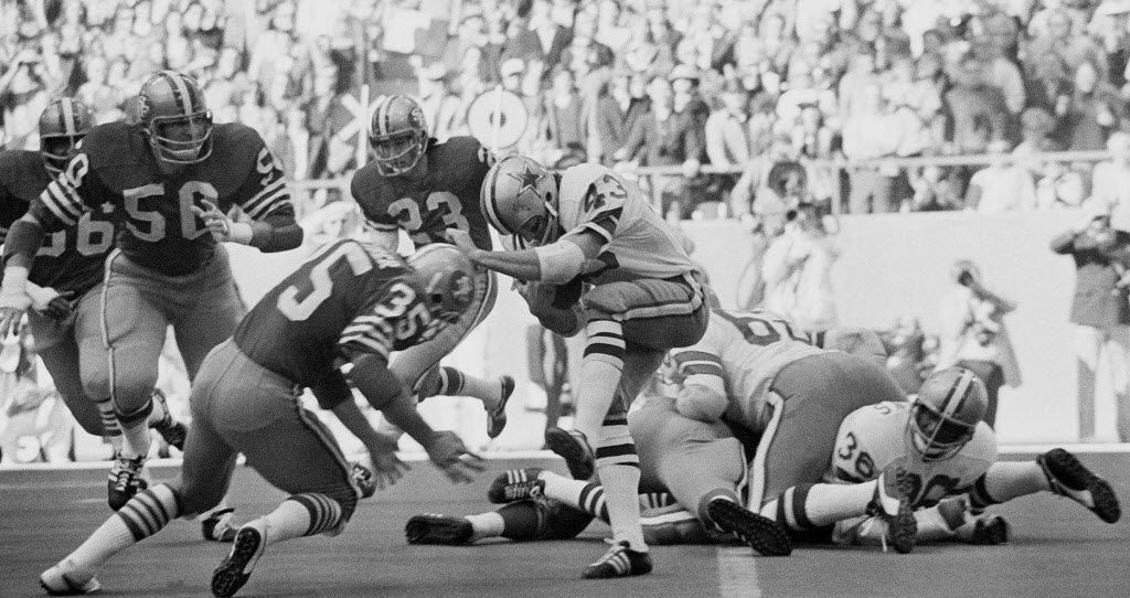 """Dallas Cowboys safety Cliff Harris (43) tries to evade a tackle by San Francisco 49ers running back Larry Schreiber (35) on the opening kickoff of the NFC Championship game on Jan. 2, 1972, at Texas Stadium. The Cowboys would win the game, 14-3, and go shed the """"next year's champions"""" label with their first Super Bowl win, 24-3 over the Miami Dolphins."""