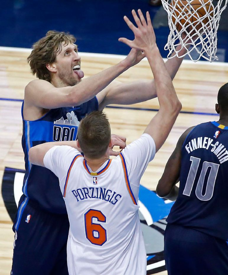 Dallas Mavericks forward Dirk Nowitzki (41) lays up the ball against New York Knicks forward Kristaps Porzingis (6) during the third quarter at American Airlines Center in Dallas on Jan. 25, 2017. The Dallas Mavericks won 103-95. (Jae S. Lee/The Dallas Morning News)