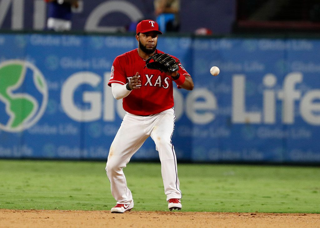 Texas Rangers shortstop Elvis Andrus (1) fields a ground out by Boston Red Sox' Mitch Moreland in the eighth inning of a baseball game in Arlington, Texas, Tuesday, Sept. 24, 2019. (AP Photo/Tony Gutierrez)
