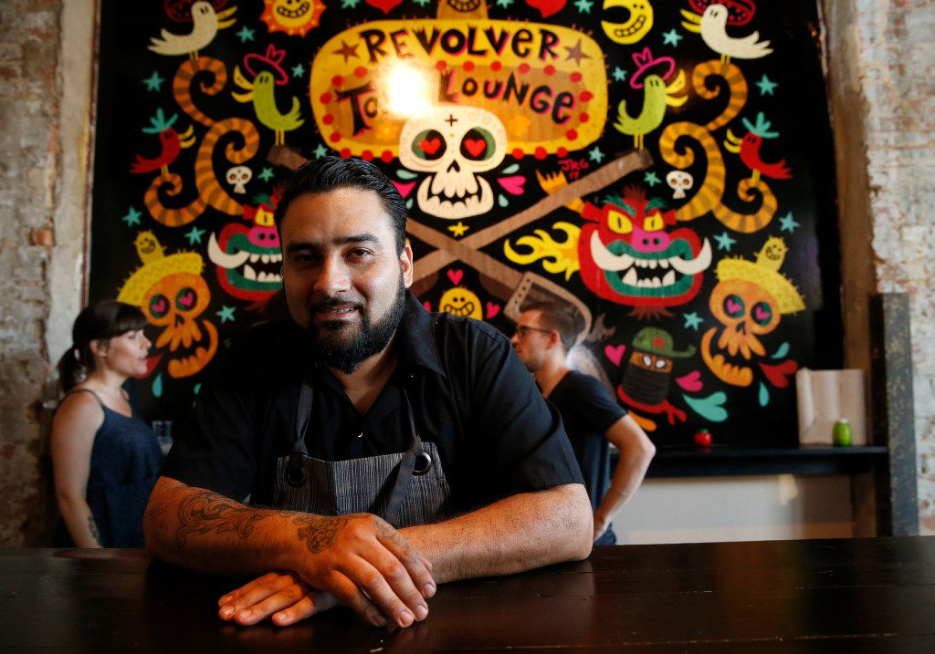 Owner Regino Rojas in front of Jorge Gutierrez's colorful mural (Vernon Bryant/The Dallas Morning News)