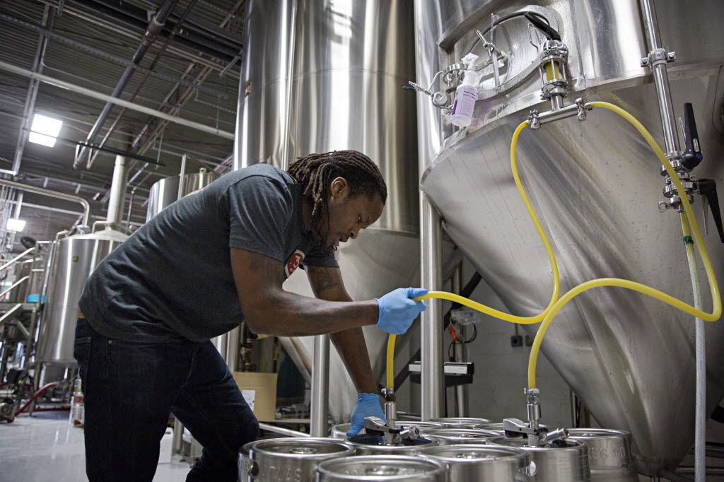 Steven Aikens fills kegs with beer at 3 Nations Brewing Friday, October 16, 2015 in Farmers Branch, Texas. The brewery has been in operation for about four months, and currently produces three different kinds of beer.
