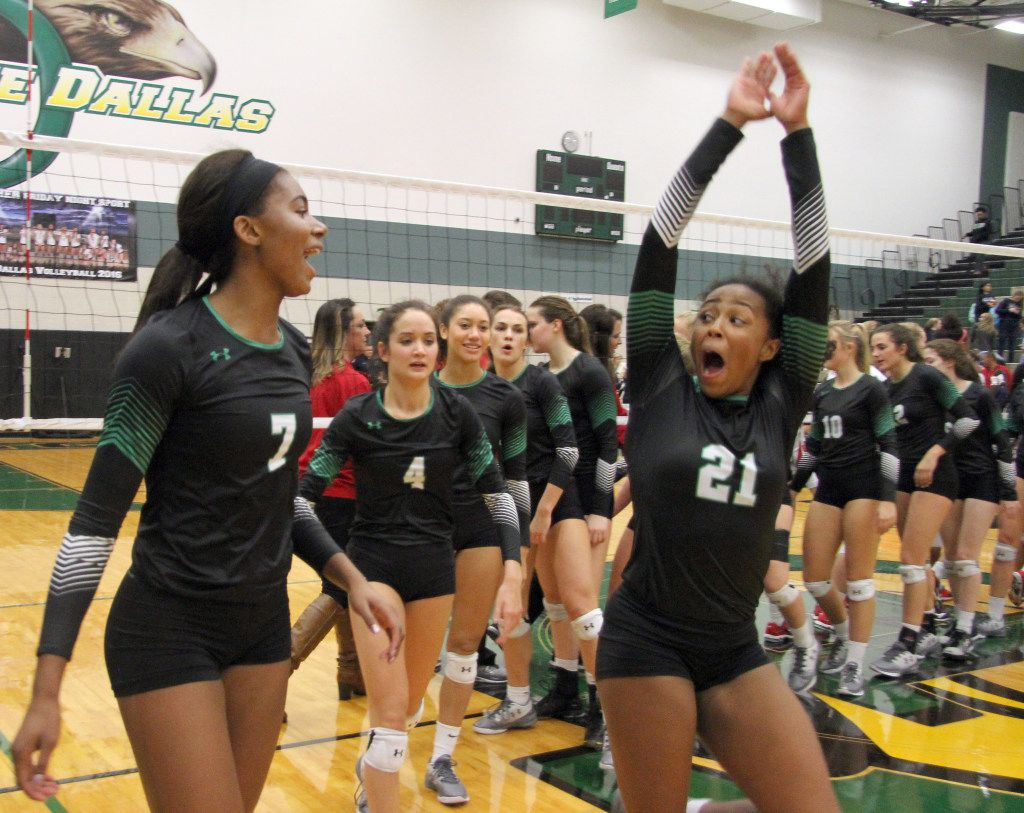 After defeating Allen in 3 straight sets, Nailah Gordon (21) and Asjia O'Neal (7) shake the hands of their opponents and are the first to start the team celebration. The two teams played their Class 6A Region l quarterfinal volleyball game at Lake Dallas High School in Corinth on November 8, 2016. (Steve Hamm/Special Contributor)