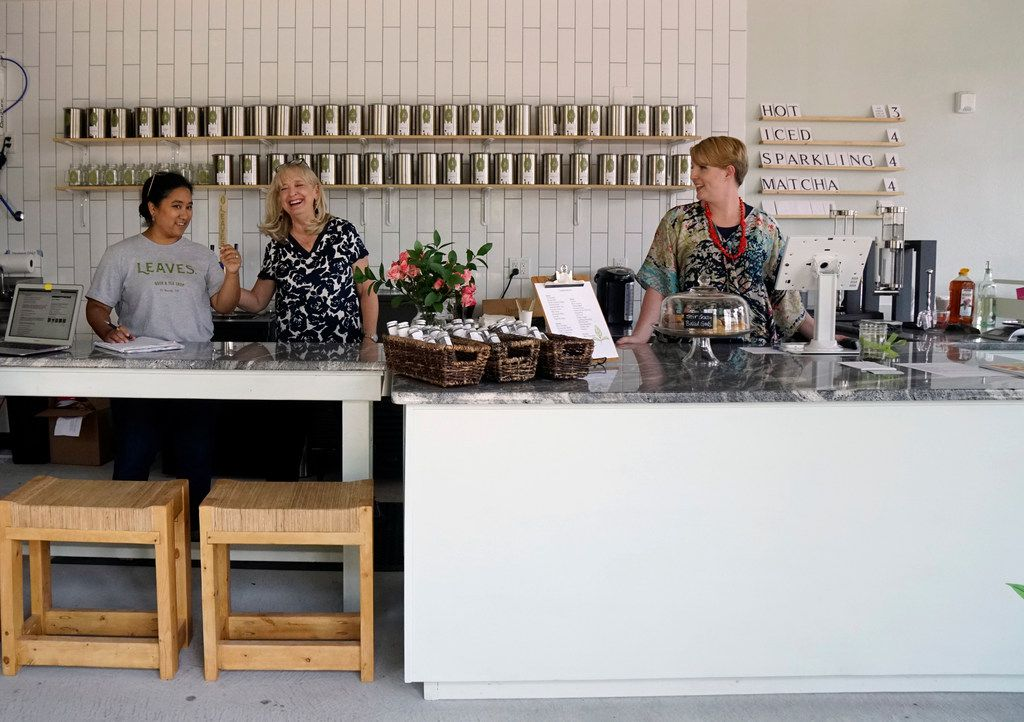 Tina Howard jokes around with employees Michele Fischer and Tiffany Malkowski at Leaves Book and Tea Shop  in Fort Worth.
