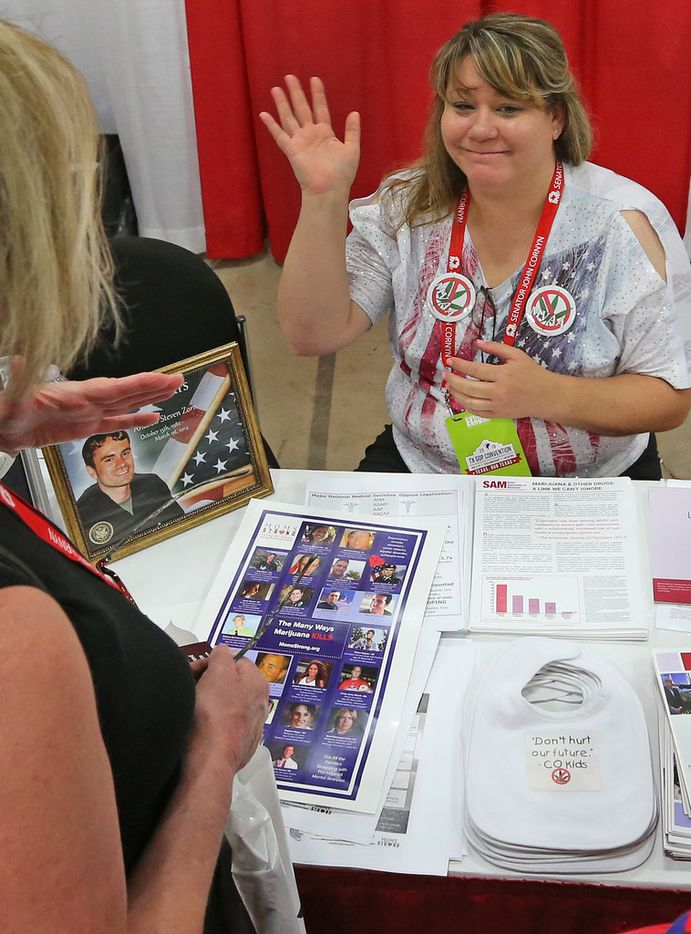Aubree Adams talks with delegates as they pass by her at the Texans Against Legalizing Marijuana booth at the 2018 Texas GOP Convention held at the Henry B. Gonzalez Convention Center in downtown San Antonio. Texas on Thursday, June 14, 2018.