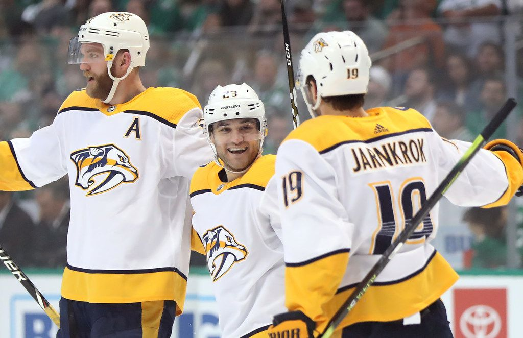DALLAS, TEXAS - APRIL 15:  Rocco Grimaldi #23 of the Nashville Predators celebrates a goal with Mattias Ekholm #14 and Calle Jarnkrok #19 in the second period of Game Three of the Western Conference First Round during the 2019 NHL Stanley Cup Playoffs at American Airlines Center on April 15, 2019 in Dallas, Texas. (Photo by Ronald Martinez/Getty Images)