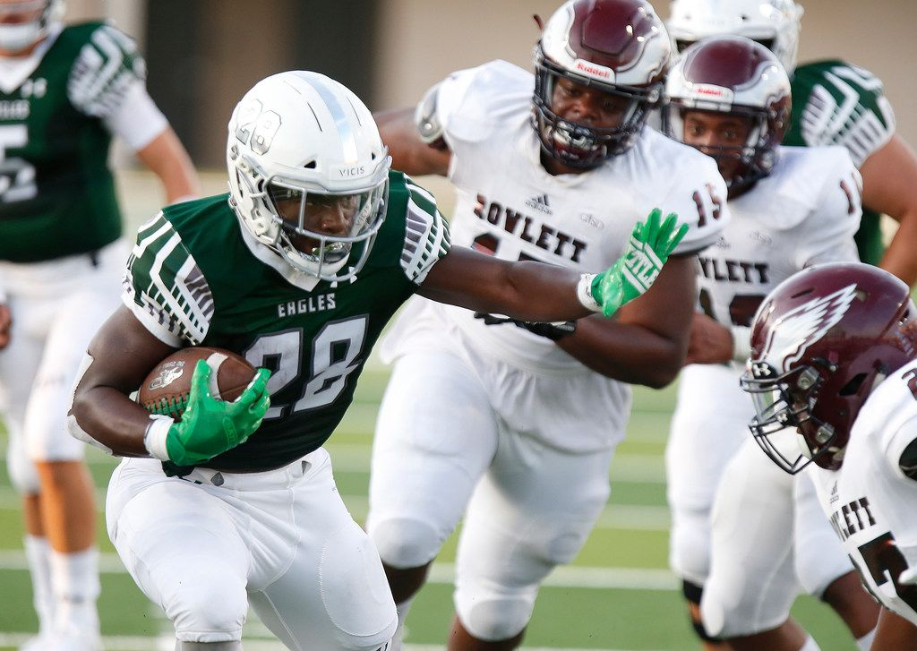 Prosper High School running back JT Lane (28) carries the ball into the end zone during the first half as Prosper High School hosted Rowlett High School in a non-district football game at Children's Health Stadium in Prosper on Friday, August 30, 2019. (Stewart F. House/Special Contributor)