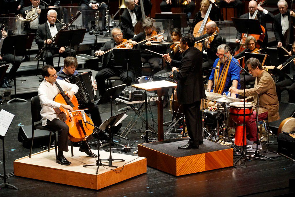 "From left: Jesus Castro-Balbi (cello), Michael Ward-Bergeman (Hyper Accordion),   Cyro Baptista (percussions), Jamey Haddad (percussions), perform Ozvaldo Golijov's ""Azul"" with conductor Miguel Harth-Bedoya and the Fort Worth Symphony Orchestra at Bass Performance Hall in Fort Worth on Aug. 31, 2019."