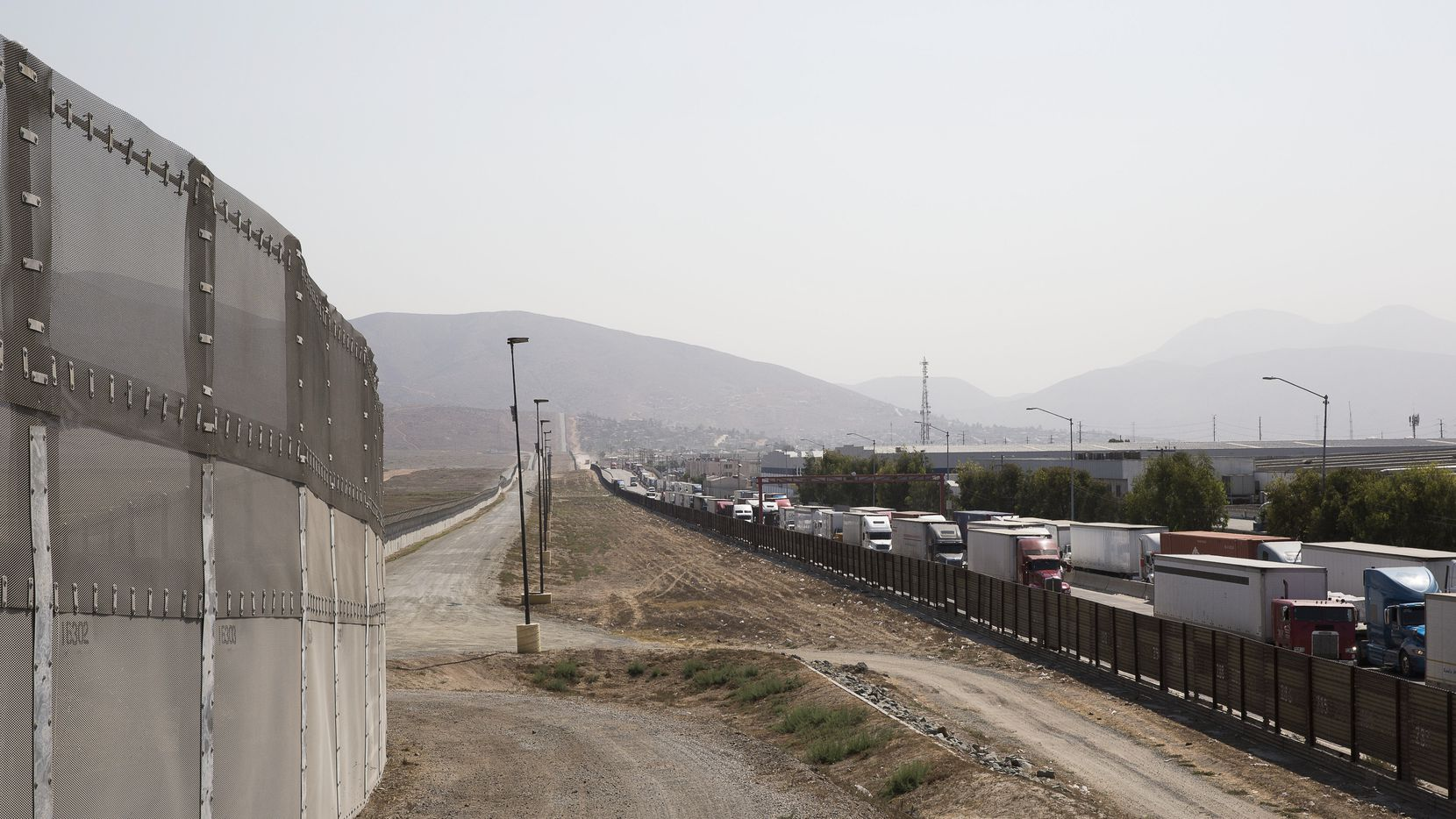 A long line of trucks coming from Tijuana, Mexico, enter the U.S., on the south end of San Diego, Aug. 26, 2016. Abandoning the free-trade deal with America's neighbors would mean upending major industries and a generation's worth of economic integration.