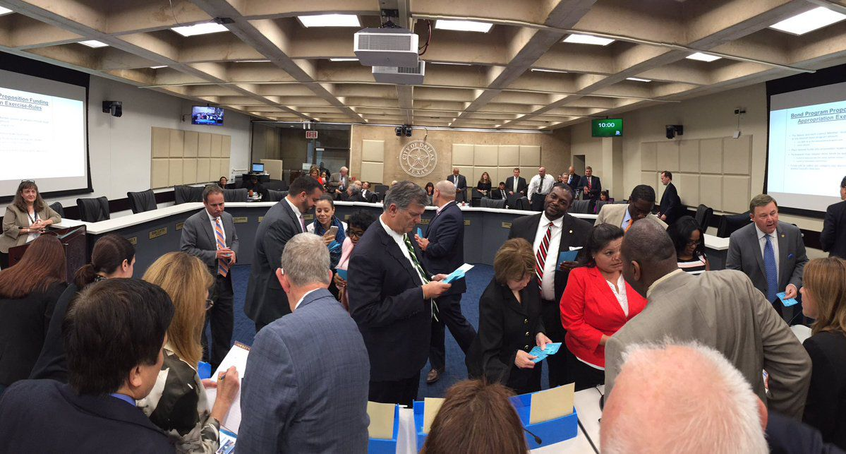 The City Council dropped some fake money in some boxes to show its appetite — or lack thereof — for bond spending. (City of Dallas)