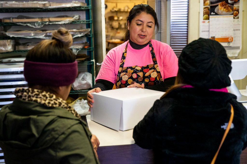 Naomi Vera Chavarria center, helps customers purchase a birthday cake at Vera's Bakery Inc. in Dallas on Nov. 13, 2018.