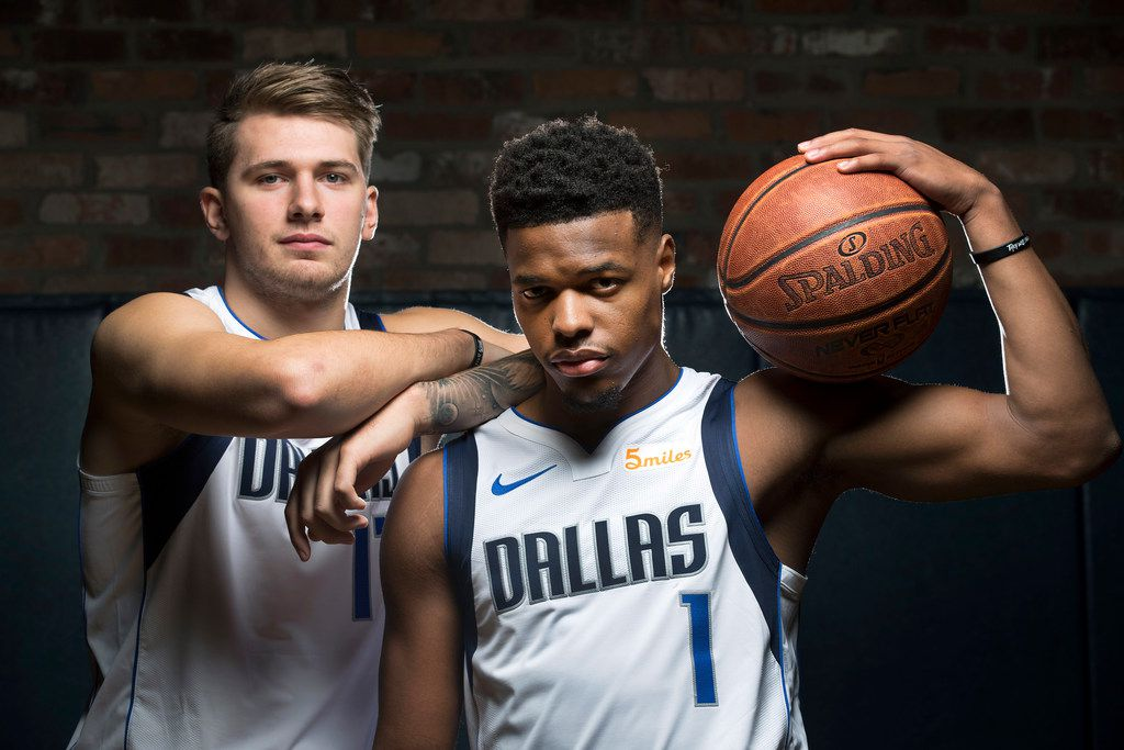 Dallas Mavericks Luka Doncic (left) and Dennis Smith Jr. pose for a photo during Dallas Mavericks Media Day at the American Airlines Center in Dallas, Friday, September  21, 2018. (Tom Fox/The Dallas Morning News)