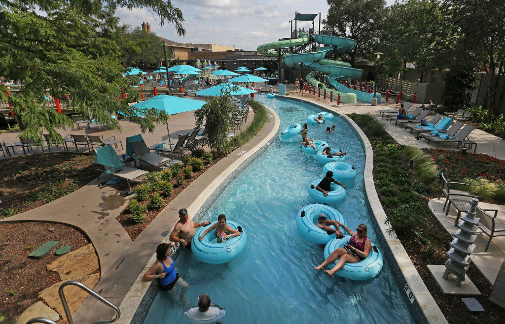 Swimmers enjoy a trip on the lazy river at JadeWaters at the Hilton Anatole Hotel in Dallas, photographed on Friday, May 26, 2017.