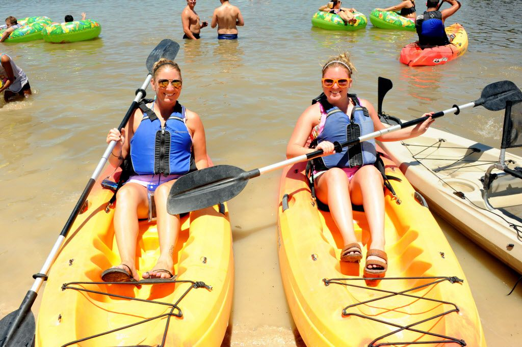 Friends canoe in the Trinity River at Sunday Funday at Panther Island Pavilion