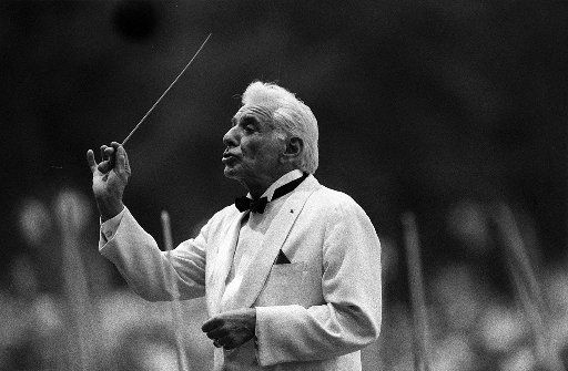 Leonard Bernstein conducts the New York Philharmonic Orchestra in  August 1986 in Central Park.