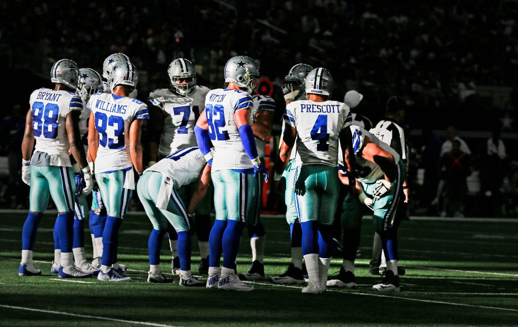 The Dallas offense, led by quarterback Dak Prescott (4) huddles in the fourth quarter during the New York Giants vs. the Dallas Cowboys NFL football game at AT&T Stadium in Arlington, Texas on Sunday, September 11, 2016. (Louis DeLuca/The Dallas Morning News)