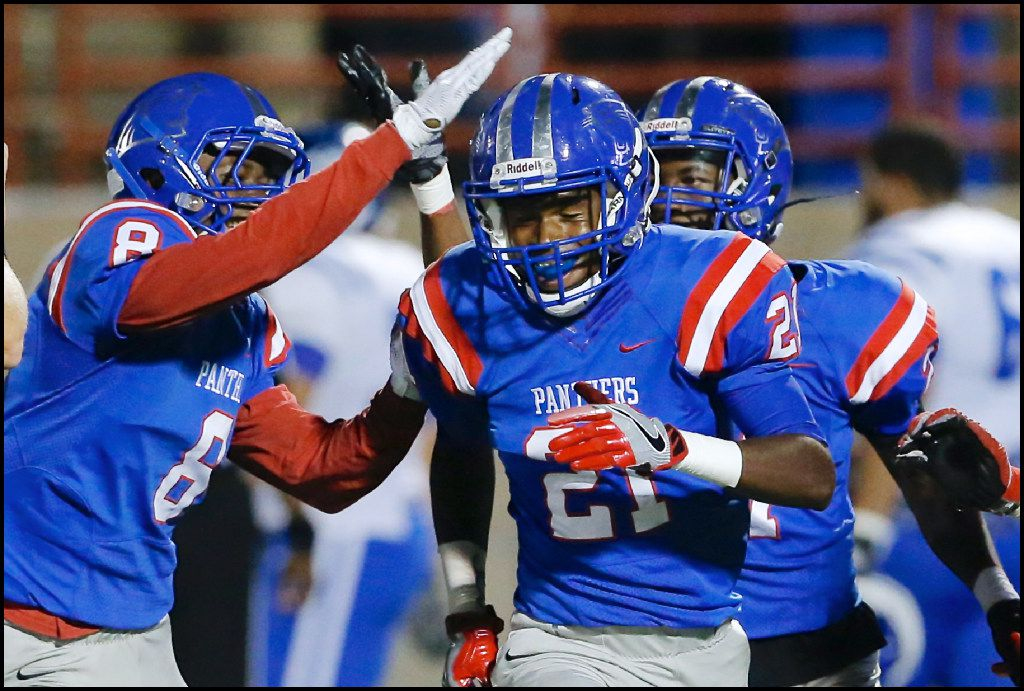 Duncanville sophomore defensive back Treshone Devones (21) is congratulated by senior defensive back Eli Jones (8) after intercepting a pass during the first half of a football game against Grand Prairie at Duncanville High School, Thursday, November 3, 2016. (Brandon Wade/Special Contributor)